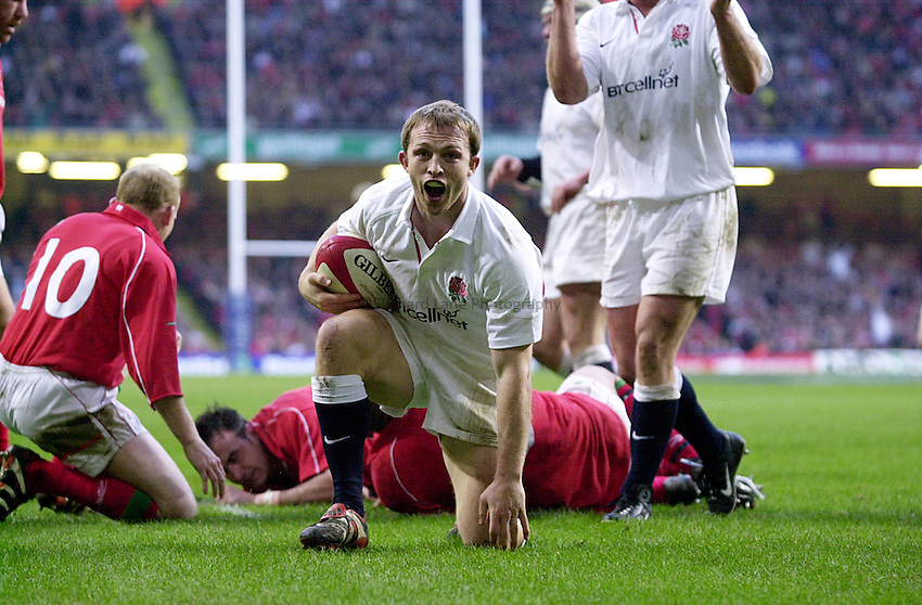 Photo Richard Lane..Wales vs England. .Lloyds T.S.B Six Nations Championship 2001..Millenium Stadium, Cardiff. 03.02.2001.Matt Dawson begins the celebrations after he scores another England try..