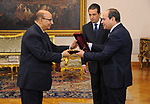 Egyptian President Abdel-Fattah el-Sisi,  listens to the new head of the State Council during a swearing, in Cairo, Egypt, on July 20, 2017. Photo by Egyptian President Office