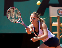 Dominika Cibulkova (SVK) (20) against Agnes Szavay (HUN) (29) in the fourth round of the Women's SIngles. Cibulkova beat Szavay 6-2 6-4..Tennis - French Open - Day 8 - Sun 31st May 2009 - Roland Garros - Paris - France..Frey Images, Barry House, 20-22 Worple Road, London, SW19 4DH.Tel - +44 20 8947 0100.Cell - +44 7843 383 012