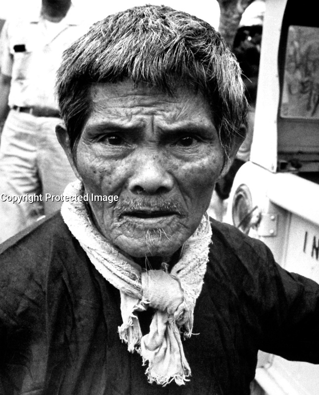 The strain shows clearly on the face of the Vietnamese, farmer, one of 4,500 who recently fled their homes to escape Vietcong harassment.  The refugees left hamlets which had been family homes for generations.  Ca. 1966.  (USIA)<br /> EXACT DATE SHOT UNKNOWN<br /> NARA FILE #:  306-MVP-22-11<br /> WAR &amp; CONFLICT BOOK #:  408