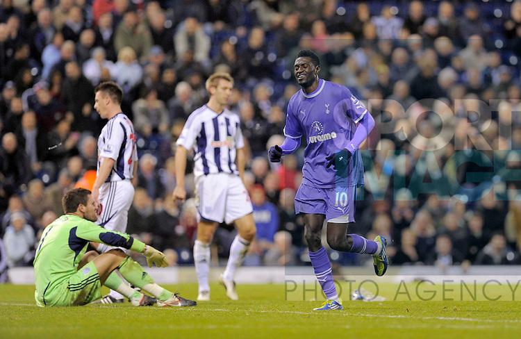 Emmanuel Adebayor celebrates his goal, Tottenham's third of the game.