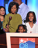 Denver, CO - August 25, 2008 -- Sasha Obama, bottom center, youngest daughter of United States Senator Barak Obama (Democrat of Illinois), plays with the gavel as her mother, Michelle Obama, top center, looks on during a walk-through prior to the opening of Day 1 of the 2008 Democratic National Convention at the Pepsi Center in Denver, Colorado on Monday, August 25, 2008.  Sasha's sister, Malia Ann, looks on from right..Credit: Ron Sachs - CNP.(RESTRICTION: NO New York or New Jersey Newspapers or newspapers within a 75 mile radius of New York City)
