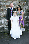 Kirsty Maxim, who made her First Communion on Saturday at Clogherhead church, pictured with parents Alison and Michael.