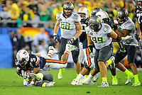 Jan 10, 2011; Glendale, AZ, USA; Auburn Tigers running back Michael Dyer (5) uses his hand to stay off the grass as Oregon Ducks defender Eddie Pleasant attempts to tackle him during the fourth quarter of the 2011 BCS National Championship game at University of Phoenix Stadium.  Mandatory Credit: Mark J. Rebilas-