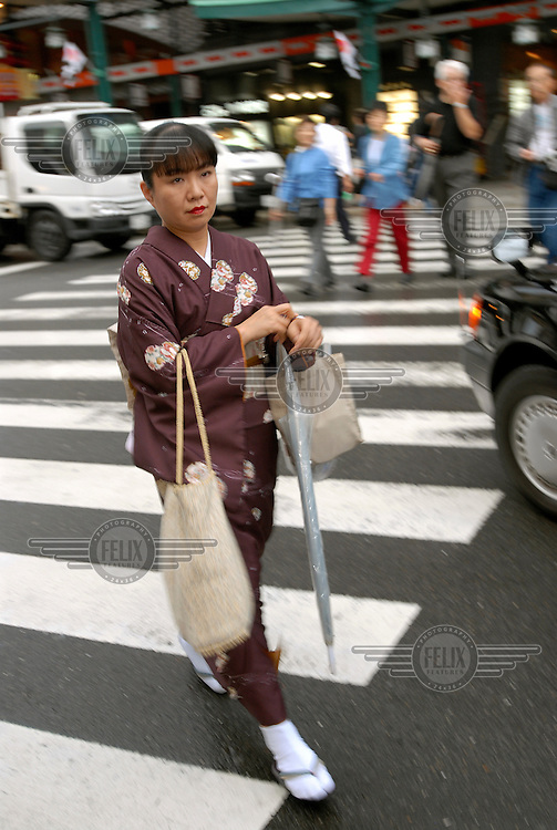 Woman in traditional dress in the Gion historical quarter of Kyoto.