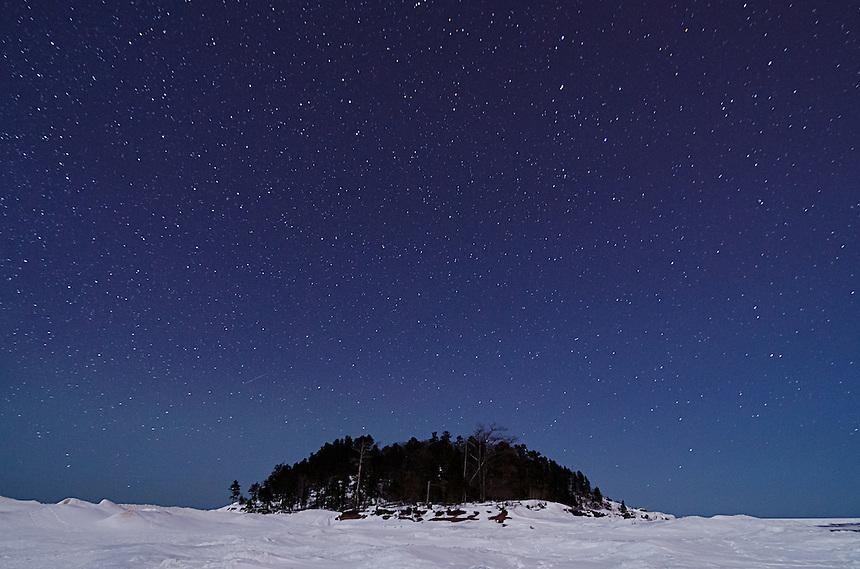 A view of Little Presque Isle on clear winter night. Marquette, MI