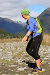 NELSON LAKES, NEW ZEALAND - APRIL 18:  Sue Moore crosses the Travers River during the 2015 Alpine Lodge Loop The Lake trail run at Lake Rotoiti on April 18 16, 2015 in Nelson, New Zealand. (Photo by Marc Palmano/Shuttersport Limited)