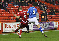 Ryan McGuffie tackling Andrew Considine in the Aberdeen v Queen of the South William Hill Scottish Cup 5th Round match played at Pittodrie Stadium, Aberdeen on 4.2.12.