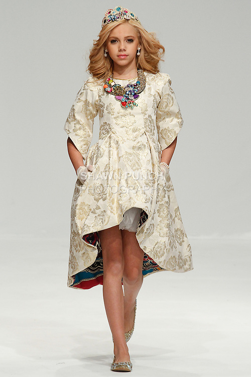 """Model walks runway in an outfit from the LaRox by Roxie Marie & Lilliana Velazquez """"Majestic Royal"""" collection, during the Fashion Gallery New York Fall 2014 Fashion Week, at the Helen Mills Space, February 8, 2014."""