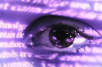 Closeup of an eye with words projected on it.