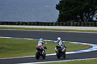 PHILLIP ISLAND, 27 FEBRUARY - Carlos Checa (ESP) riding the Ducati 1098R (7) of the Althea Racing Team and Marco Melandri (ITA) riding the Yamaha YZF R1 (33) of the Yamaha World Superbike Team gestures to each other after race one of round one of the 2011 FIM Superbike World Championship at Phillip Island, Australia. (Photo Sydney Low / syd-low.com)