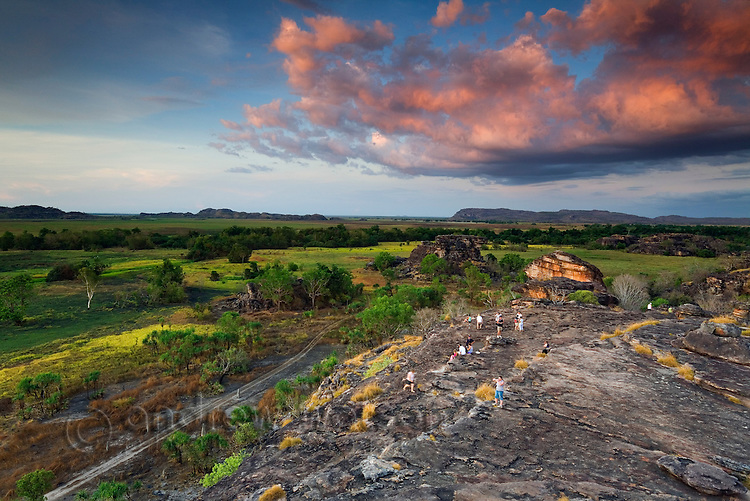 Sunset at the sacred Aboriginal site of Ubirr, overlooking the Nadab floodplain.  Kakadu National Park, Northern Territory, AUSTRALIA.