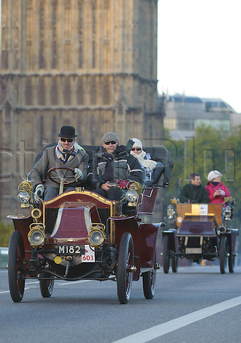 3.11.2013 London, England.  Competitor #601 entered by Mr Steven Coburn [GBR} Camberley M 182 1905 Renault on Westminster Bridge, during the annual 'London to Brighton Veteran Car Run' on November 03, 2013 organised by the Royal Automobile Club. The Royal Automobile Club's 60 mile drive from the capital to the south coast is the longest running motoring event in the world, and attracts entrants from across the globe.