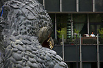 """July 18, 2014, Tokyo, Japan - A man sees from the next building the 6.6 meter model of the new Godzilla at Tokyo Midtown on July 18, 2014, Tokyo. The statue is a 1/7 scale reproduction of the 180 meters tall Hollywood film version of """"GODZILLA"""".  Godzilla and its footprints will be displayed from July 18 to August 31 during which time it will perform a special show using mist, light and sound effects every 30 minutes between 19:00 to 21:00. (Photo by Rodrigo Reyes Marin/AFLO)"""
