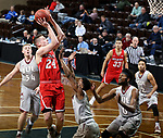SIOUX FALLS, SD - MARCH 12:  Kyle Mangas #24 from Indiana Wesleyan shoots a jumper over Datrion Harper #3 from IU East during their semifinal game at the 2018 NAIA DII Men's Basketball Championship at the Sanford Pentagon in Sioux Falls. (Photo by Dave Eggen/Inertia)