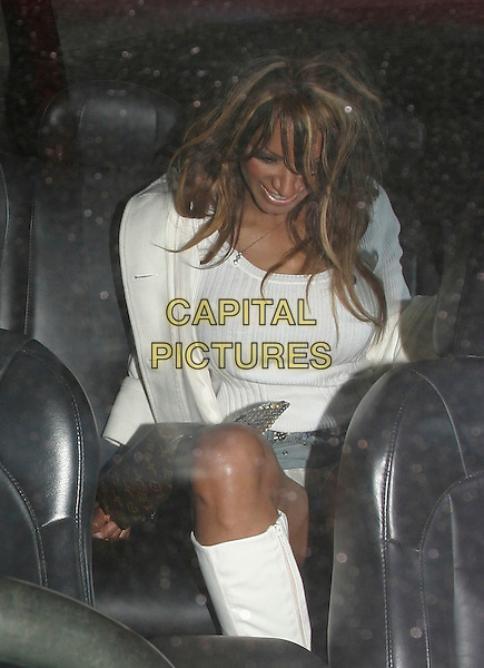 TRACI BINGHAM.Celebrity Big Brother Party, .Astor Bar & Grill, Glasshouse Street, .London, England, 30th January 2006..half length getting into car shot knickers flashing white top boots.Ref: AH.www.capitalpictures.com.sales@capitalpictures.com.©Adam Houghton/Capital Pictures.