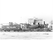 Engineer side of D&amp;RGW #475 K-28 with tender with Alamosa Flour Mills in background.<br /> D&amp;RGW  Alamosa, CO  7/4/1941