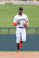 Salt River Rafters right fielder Monte Harrison (4), of the Miami Marlins organization, jogs off the field between innings of an Arizona Fall League game against the Surprise Saguaros at Salt River Fields at Talking Stick on October 23, 2018 in Scottsdale, Arizona. Salt River defeated Surprise 7-5 . (Zachary Lucy/Four Seam Images)