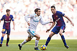 Mateo Kovacic (L) of Real Madrid fights for the ball with Sergio Busquets Burgos of FC Barcelona during the La Liga 2017-18 match between Real Madrid and FC Barcelona at Santiago Bernabeu Stadium on December 23 2017 in Madrid, Spain. Photo by Diego Gonzalez / Power Sport Images
