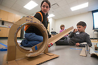 NWA Democrat-Gazette/BEN GOFF @NWABENGOFF<br /> Theresa Higson, Scott Family Amazeum programs educator, and Mason Wood, 8, of Pea Ridge try to get a Hot Wheels car to go through a loop made from recycled materials Wednesday, March, 21, 2018, during the &quot;Wheels, Wings &amp; Motorized Things&quot; Spring Break camp at the Scott Family Amazeum in Bentonville. The camp, inspired by the museum's temporary exhibit Hot Wheels: Race to Win, gives campers hands on opportunities to explore elements of physics such as gravity, friction and momentum.