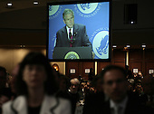 Members of the audience listen as United States President George W. Bush, seen on screen in background, makes remarks at the National Catholic Prayer Breakfast in Washington on April 18, 2008. <br /> Credit: Yuri Gripas / Pool via CNP
