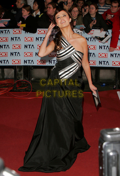 CHANTELLE HOUGHTON.Arrivals -12th Annual National Television Awards 2006, held at the Royal Albert Hall, London, England, .October 31st 2006..full length black and white striped one shoulder dress Preston hand touching hair Alexander McQueen.CAP/AH.©Adam Houghton/Capital Pictures.