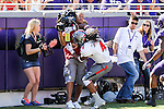 Texas Tech Red Raiders wide receiver Bradley Marquez (4) plows into a camera man during the game between the Texas Tech Red Raiders and the TCU Horned Frogs at the Amon G. Carter Stadium in Fort Worth, Texas. TCU defeats Texas Tech 82 to 27.