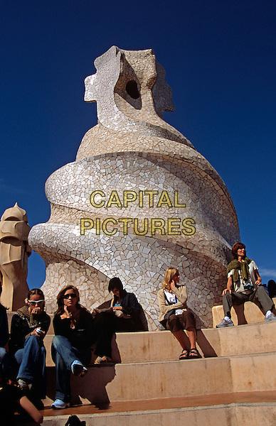 Roof sculpture and tourists, La Pedrera, Casa Mila, Barcelona, Spain.