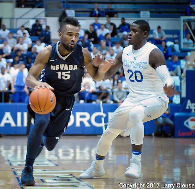 February 15, 2017:  Nevada guard, D.J. Fenner #15, works against Falcon, Trevor Lyons #20, during the NCAA basketball game between the University of Nevada Wolfpack and the Air Force Academy Falcons, Clune Arena, U.S. Air Force Academy, Colorado Springs, Colorado.  Nevada defeats Air Force 78-59.