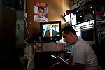 8 July 2009 - Tegucigalpa, Honduras  Son of Bertha watching Zelaya on television. Bertha Lydia Rodriguez Paz is a local coordinator for the Liberal Party of Honduras and supporter of ousted Honduran President Manuel Zelaya. Photo credit: Benedicte Desrus