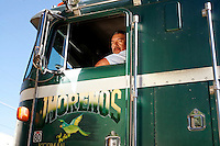 Jose Moreno sits in his truck at his home in Kerman, Calif., on the morning of Sunday, June 18, 2006.  Jose Moreno first came to the USA in 1984 after several year in the Mexican Army.  He began working for Adolphson Family Vineyards, eventually becoming the ranch foreman for 11 years.  In 2001, Jose and his wife Julie received their green cards and joined their children as U.S. citizens.  Recently, the family has moved in the city of Kerman, Calif. where Alex and Mary attend high school.  Jose now works as a freelance trucker.  Jose Jr. works as Network administrator at the Kerman Unified School district.  The second oldest, Aselly, lives in Anchoridge, Alaska: while her husband serves the U.S. military in Iraq. (Photo by Bryce Yukio Adolphson/Brooks Institute of Photography, &copy; 2006)<br />