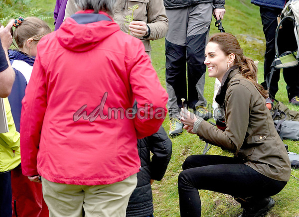 Kate Duchess of Cambridge Katherine Catherine Middleton talks with some ramblers during a visit to Deepdale Hall Farm, a traditional fell sheep farm, in Patterdale, Cumbria. Photo Credit: ALPR/AdMedia