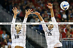 KANSAS CITY, KS - DECEMBER 14: Heidi Helen #19 and Haleigh Washington #15 of Penn State University jumps for a block against the University of Nebraska during the Division I Women's Volleyball Semifinals held at Sprint Center on December 14, 2017 in Kansas City, Missouri. (Photo by Tim Nwachukwu/NCAA Photos via Getty Images)