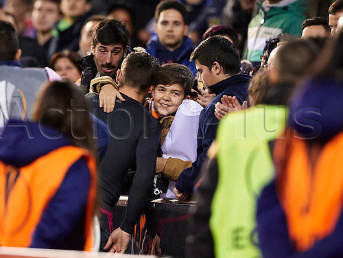 18.02.2016. Mestalla Stadium, Valencia, Spain. Europa League. Valencia versus Rapid Wien. Goal Keeper Mathew Ryan oF Valencia CF hugs a child from the crowd after giving him his jersey
