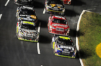 Oct. 17, 2009; Concord, NC, USA; NASCAR Sprint Cup Series driver Jimmie Johnson (48) leads Jeff Gordon and Kasey Kahne during the NASCAR Banking 500 at Lowes Motor Speedway. Mandatory Credit: Mark J. Rebilas-