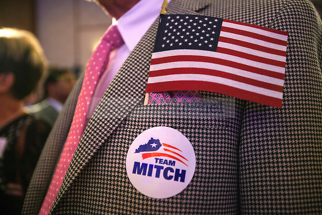 A supporter of Senate Minority Leader Mitch McConnell, displays an american flag in his pocket at the Marriott hotel in Louisville, Kentucky, U.S., on Tuesday, Nov. 4, 2014. Photo by Michael Reaves | Staff