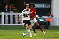 Mattias Kait of Fulham U23's tries to shield the ball from Manchester United U23's Tahith Chong during Fulham Under-23 vs Manchester United Under-23, Premier League 2 Football at Motspur Park on 10th August 2018