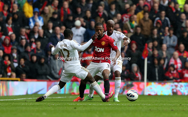 Pictured: (L-R) Nathan Dyer, Patrice Evra, Dwight Tiendalli.<br /> Sunday 12 May 2013<br /> Re: Barclay's Premier League, Manchester City FC v Swansea City FC at the Old Trafford Stadium, Manchester.