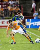 Seattle Sounders defender Leo Gonzalez (19) pushes Houston Dynamo midfielder Brian Mullan (9).  Houston Dynamo tied Seattle Sounders 1-1 on August 23, 2009 at Robertson Stadium in Houston, TX.