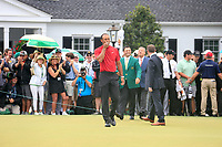 Tiger Woods (USA) walks out onto the putting green at The 2019 Masters , Augusta National, Augusta, Georgia, USA. 14/04/2019.<br /> Picture Fran Caffrey / Golffile.ie<br /> <br /> All photo usage must carry mandatory copyright credit (© Golffile | Fran Caffrey)