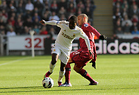 Pictured: Swansea's Nathan Dyer goes around Yoan Gouffran<br />