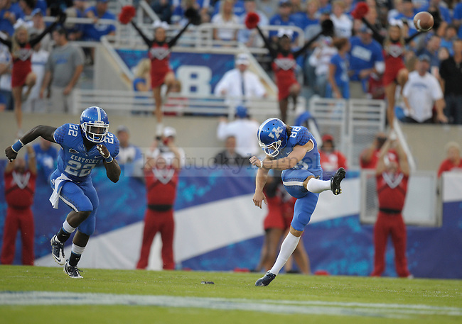Joe Mansour kicks off the ball during the first half of the University of Kentucky football game against Louisville at Commonwealth Stadium in Lexington, Ky., on 9/17/11. UK trailed the game 10-14 at half. Photo by Mike Weaver | Staff