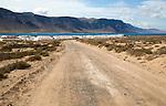 Dirt track leading to Caleta de Sebo village on Graciosa island, Lanzarote, Canary Islands, Spain