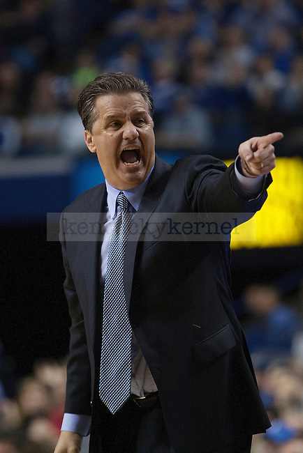 UK head coach John Calipari yells at his team during the second half of the University of Kentucky men's basketball game vs. Belmont University at Rupp Arena in Lexington, Ky., on Saturday, December 21, 2013. Kentucky defeated Belmont 93-80. Photo by Michael Reaves | Staff.