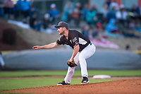 Salem-Keizer Volcanoes relief pitcher Mack Meyer (40) follows through on his delivery during a Northwest League game against the Eugene Emeralds at Volcanoes Stadium on August 31, 2018 in Keizer, Oregon. The Eugene Emeralds defeated the Salem-Keizer Volcanoes by a score of 7-3. (Zachary Lucy/Four Seam Images)