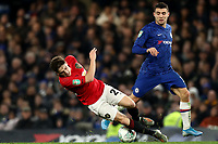 30th October 2019; Stamford Bridge, London, England; English Football League Cup, Carabao Cup, Chelsea Football Club versus Manchester United; Mateo Kovacic of Chelsea fouls Daniel James of Manchester Utd - Strictly Editorial Use Only. No use with unauthorized audio, video, data, fixture lists, club/league logos or 'live' services. Online in-match use limited to 120 images, no video emulation. No use in betting, games or single club/league/player publications