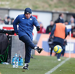 Ally McCoist boots the ball back into play