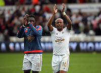 Pictured L-R: Co-scorers Bafetimbi Gomis and Andre Ayew of Swansea thank home supporters after the end of the game Sunday 30 August 2015<br /> Re: Premier League, Swansea v Manchester United at the Liberty Stadium, Swansea, UK