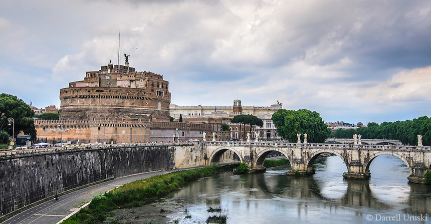 Fine Art Landscape Print Photograph. The Mausoleum of Hadrian, usually known as the Castel Sant'Angelo in Rome, Italy.<br /> The reflections from the bridge on the river Tiber combined with the dramatic clouds really added a historic feeling to the image. <br /> The details in the bridge and castle further complement the emotion of this photograph.