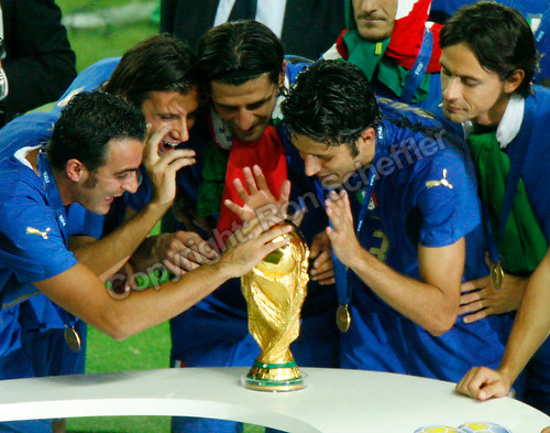 Jul 9, 2006; Berlin, GERMANY; Italy players admire the World Cup during the trophy presentation after defeating France 5-3 on penalty kicks following a 1-1 draw after extra time in the final of the 2006 FIFA World Cup at the Olympiastadion, Berlin. Mandatory Credit: Ron Scheffler-US PRESSWIRE Copyright © Ron Scheffler